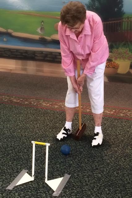 Active Senior Living Resident Playing Croquet