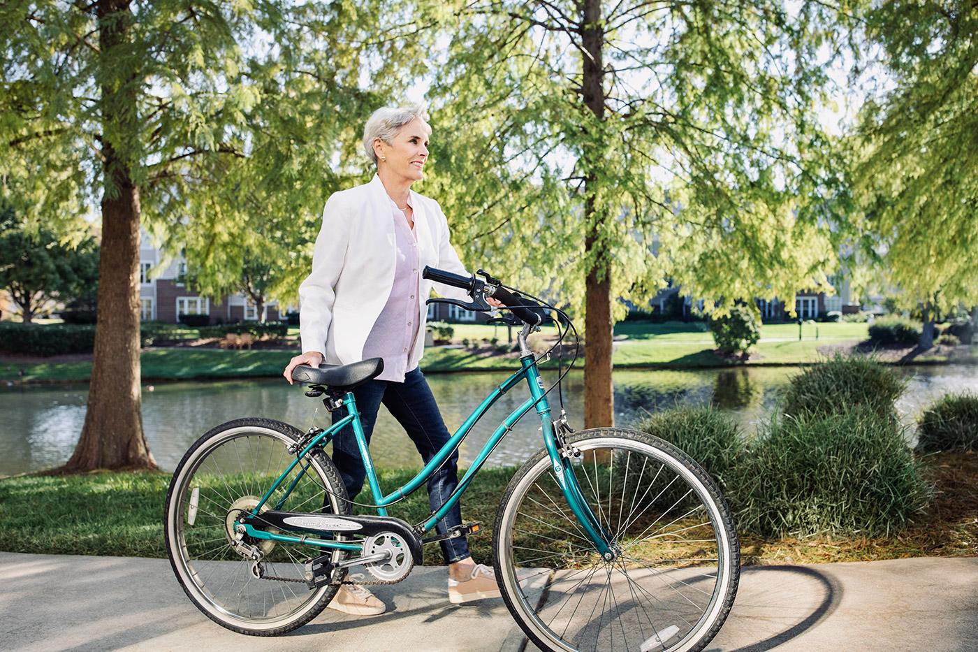 women on a sidewalk with her bike
