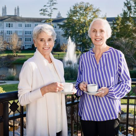 two ladies having a cup to drink