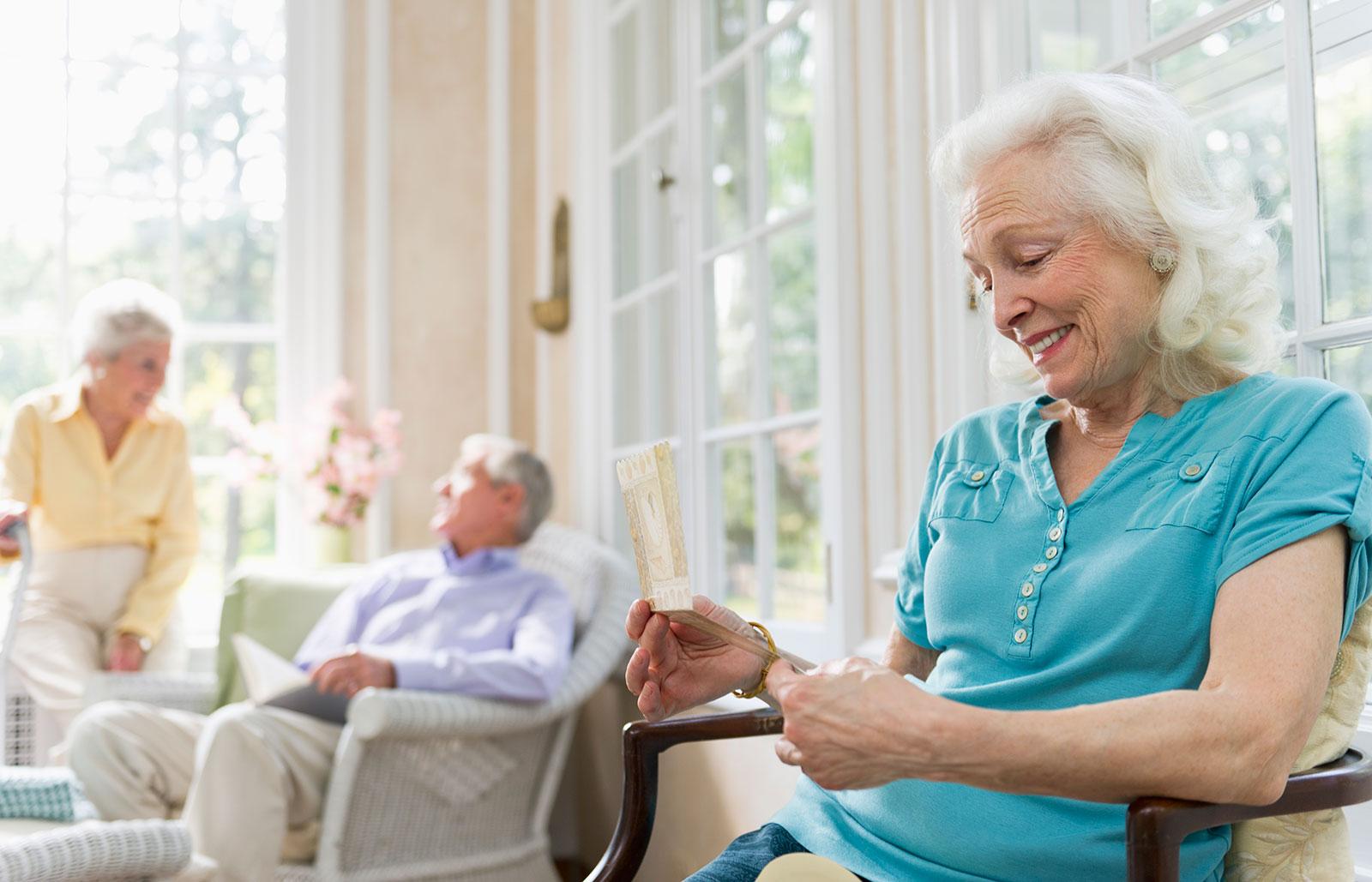 elderly reading a card